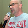 WARREN DILLAWAY / Star Beacon<br /> NICK IAROCCI,  St. John High School athletic director, gets students fired up on Monday during a pep rally in honor of Ohio State football coach Urban Meyer who graduated from the school in 1982. Oho State played Oregon in the national championship game on Monday night in Arlington, TX.