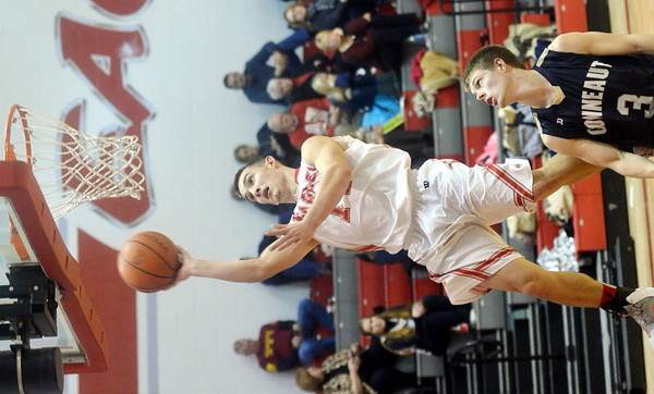 WARREN DILLAWAY / Star Beacon<br /> ZAC SWEAT of Geneva drives to the basket on Tuesday night with Nick Root (3) of Conneaut following the play at Conneaut.