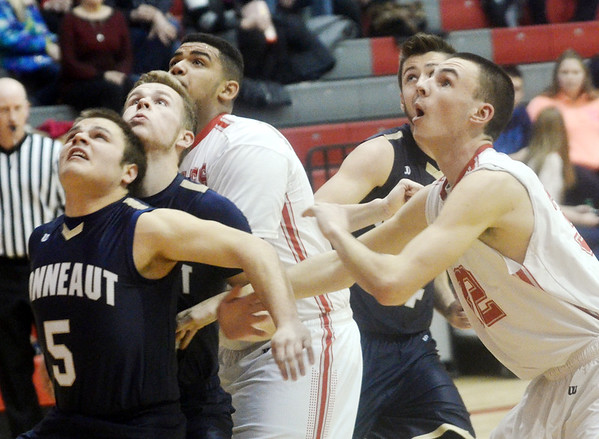 WARREN DILLAWAY / Star Beacon<br /> TROY COLUCCI (5) and Conneaut teammate Macus Barrickman block out Travon Miller as Paul Hitchcock (right) of Geneva and Alex Gerdes (back right hidden) of Conneaut wait for the rebound on Tuesday night at Geneva.