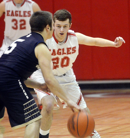 WARREN DILLAWAY / Star Beacon<br /> AIDEN HENNESSEY (20) of Geneva defends Troy Colucci of Conneaut on Tuesday night at Geneva.