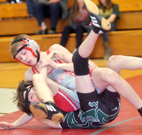 WARREN DILLAWAY / Star Beacon<br /> TYLER WILLIAMS of Lakeside (bottom) tries to keep his shoulders off the mat during a 106 pound match with Dylan Rowe of Edgewood on Thursday night at Edgewood.