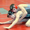 WARREN DILLAWAY / Star Beacon<br /> TANNER PERRY (top) of Edgewood wrestles Michael DeCamillo during a 120 pound bout at Edgewood on Thursday night.