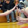 WARREN DILLAWAY / Star Beacon<br /> TANNER PERRY (left) of Edgewood wrestles Michael DeCamillo during a 120 pound bout at Edgewood on Thursday night.