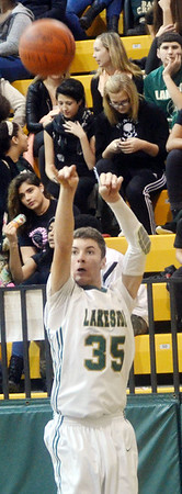 WARREN DILLAWAY / Star Beacon<br /> MATT LUNGHOFER of Lakeside shoots on Friday evening during a home game with Riverside.