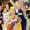WARREN DILLAWAY / Star Beacon<br /> KATE CROOKS (4) of Edgewood drives to the basket as  Delaney Saxton (right) of Brookfield defends on Saturday afternoon at Edgewood.