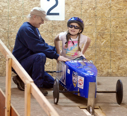 WARREN DILLAWAY/ Star Beacon<br /> MAKAYLA HURLEY of Tallmade competes in the Northeast Ohio Soap Box Derby Rally Race at Ashtabula Towne Square on Saturday morning with the help of grandfather Joe Bosich.