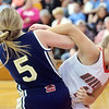 WARREN DILLAWAY / Star Beacon<br /> KATIE BOOMHOWER (right) of Edgewood fights for the ball with Alisha Quinlan of Brookfield on Saturday at Edgewood.