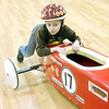 WARREN DILLAWAY / Star Beacon<br /> MASON MARTINA of Cleveland pushes his car during a break in the action at the Northeast Ohio Soap Box Derby Rally Race at Ashtabula Towne Square in Ashtabula Township on Saturday morning.
