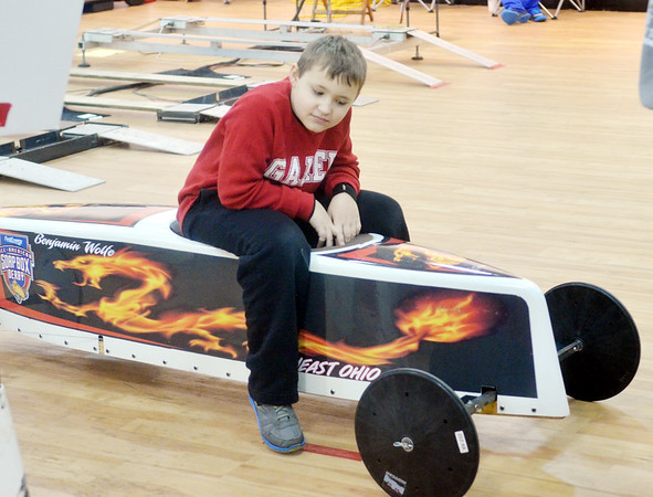 WARREN DILLAWAY / Star Beacon<br /> BENJAMIN WOLFE of North Kingsville waits for his next race during a Northeast Ohio Soap Box Derby Rally Race at Ashtabula Towne Square on Saturday. The event is free and open to the public and continues this morning at 9 a.m. with competition through late afternoon.