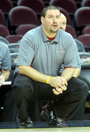 WARREN DILLAWAY / Star Beacon<br /> EDGEWOOD GIRLS basketball coach Steve Kray watches the action on Monday afternoon at Quicken Loans Arena in Cleveland.