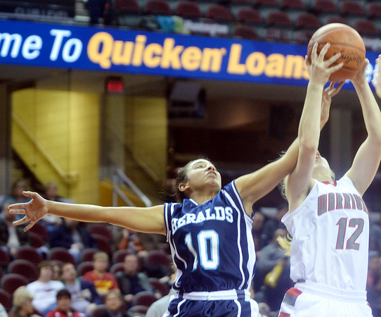 WARREN DILLAWAY / Star Beacon<br /> ALICIA NGRAINGAS  of St. John (10) battles for the ball with Taylor Diemer of Edgewood (12) on Monday afternoon at Quicken Loans Arena in Cleveland.