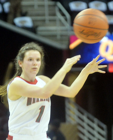 WARREN DILLAWAY / Star Beacon<br /> HALEY HOLDEN of Edgewood passes the ball to a teammate on Monday afternoon during a game with St. John at Quicken Loans Arena in Cleveland.