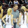 WARREN DILLAWAY / Star Beacon<br /> EDGEWOOD GIRLS basketball coach Steve Kray talks to his players prior to a game against St. John at Quickent Loans Arena in Cleveland.