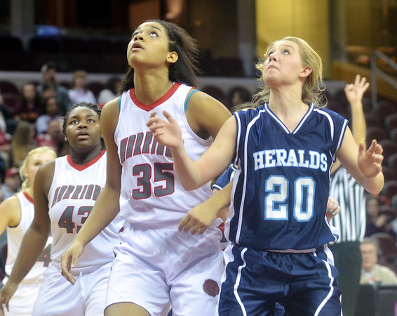 WARREN DILLAWAY / Star Beacon<br /> CHEYANNE BOSSE (20) of St. John and Iesha Niciu of Edgewood (35) wait for a rebound on Monday afternoon at Quicken Loans Arena in Cleveland.