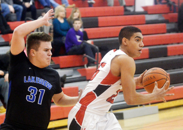 WARREN DILLAWAY / Star Beacon<br /> JAMES JACKSON (right) of Jefferson controls the ball as Chris Romano (31) of Lakeview defends on Tuesday night in Jefferson.