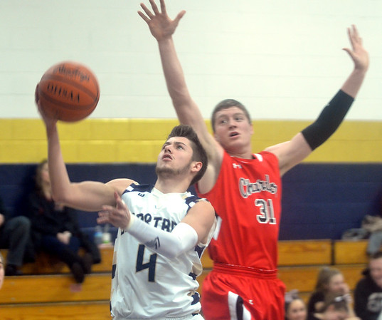 WARREN DILLAWAY / Star Beacon<br /> ALEX GERDES (4) of Conneaut drives to the basket as Drew McCartney of Chardon defends on Tuesday night at Conneaut.
