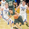 WARREN DILLAWAY / Star Beacon<br /> ISAIAH MATHERS (with ball) is defended by Corbin Anthony (11) and Madison teammate David Albert on Friday night in Madison.