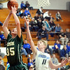 WARREN DILLAWAY / Star Beacon<br /> MATT LUNGHOFER (35) of Lakeside reaches for a rebound with Anthony Corbin (11) of Madison on Friday evening at Madison..