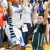 WARREN DILLAWAY / Star Beacon<br /> JODAN MCCLURE (1) of Madison looks to pass as Mo Lebron  of Lakeside (right) defends on Friday evening in Madison.