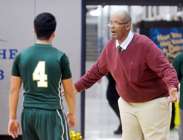 WARREN DILLAWAY / Star Beacon<br /> JAMES HOOD, Lakeside boys basketball coach, talks to Mo   Lebron (4) during a break in the action on Friday night at Madison.