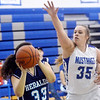 WARREN DILLAWAY / Star Beacon<br /> SAMANTHA JEAVONS (35) of Grand Valley defends Maddie Martino (33) of  St. John's on Saturday in Orwell.