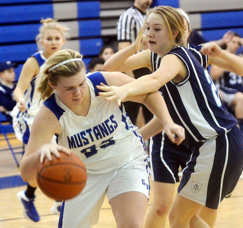WARREN DILLAWAY / Star Beacon<br /> SHAR MILLER (33) of Grand Valley dribbles as Cheyanne Bosse (right) of St. John's defends on Saturday in Orwell.