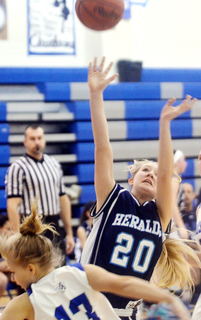 WARREN DILLAWAY / Star Beacon<br /> CHEYANNE BOSSE (20) of St. John shoots the ball as Cassady Kingdom (13) of Grand Valley falls on Saturday in Orwell.