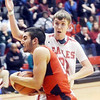 WARREN DILLAWAY / Star Beacon<br /> JACOB ADAMS of Jefferson drives by Paul Hitchcock of Geneva on Saturday at Geneva.