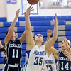 WARREN DILLAWAY / Star Beacon<br /> SAMANTHA JEAVONS (35) of Grand Valley reaches for a rebound with Mallory Shellenberger (11) and St. John's teammate Jess DiSalvatore (14) on Saturday in Orwell.
