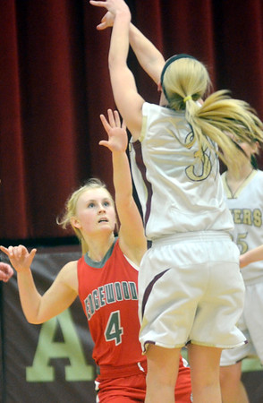 WARREN DILLAWAY / Star Beacon<br /> KATE CROOKS (4) of Edgewood defends Kelsea Brown of Pymatuning Valley on Monday evening in Andover Township.