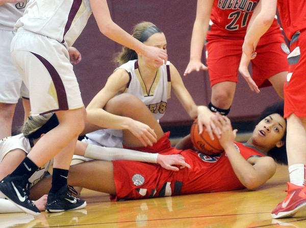 WARREN DILLAWAY / Star Beacon<br /> IESHA NICIU (holding ball) of Edgewood looks for a teammate as Rebecca Dillon (facing) of Pymatuning Valley grabs the ball on Monday in Andover Township.