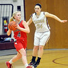 WARREN DILLAWAY / Star Beacon<br /> KENEDEE DRNEK (34) of Pymatuning Valley defends Kate Crooks (4) of Edgewood  on Monday evening in Andover Township.