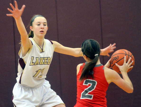 WARREN DILLAWAY / Star Beacon<br /> REBECCA DILLON (12) of Pymatuning Valley defends Ashley Evans of Edgewood on Monday evening in Andover Township.