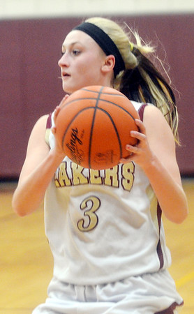 WARREN DILLAWAY / Star Beacon<br /> KELSEA BROWN of Pymatuning Valley prepares to pass on Monday evening during a home game with Edgewood.
