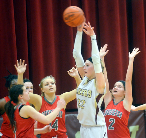 WARREN DILLAWAY / Star Beacon<br /> MEGAN STECH (22) of Pymatuning Valley is surrounded by Edgewood defenders Hailey Holden (left), Katie Boomhower (14) and Ashley Evans (2) on Monday evening in Andover Township.