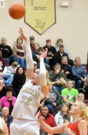 WARREN DILLAWAY / Star Beacon<br /> MEGAN STECH (22) of Pymatuning Valley shoots as Kate Crooks of Edgewood follows the play on Monday evening in Andover Township.