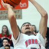 WARREN DILLAWAY / Star Beacon<br /> ELI KALIL of Edgewood prepares to shoot a layup on Tuesday evening during a home game with Lakeside.