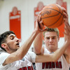 WARREN DILLAWAY / Star Beacon<br /> ELI KALIL (left) and Edgewood teammate Mason Lilja reach for a rebound on Tuesday night during a home game with Lakeside.