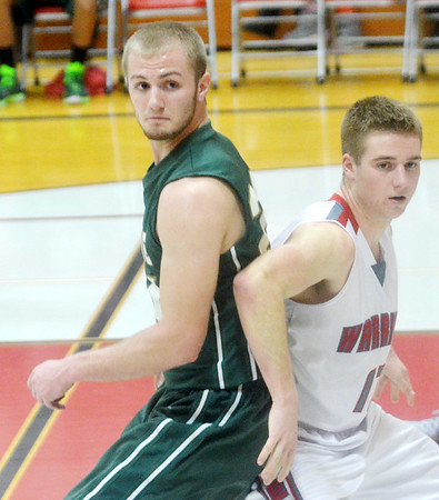 WARREN DILLAWYA / star Beacon<br /> JARED PATTON (left) of Lakeside and Mason Lilja of Edgewood battle for position on Tuesday night at Edgewood.
