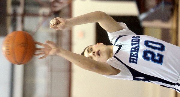 WARREN DILLAWAY / Star Beacon<br /> NATE SEVERINO of St. John shoots a foul shot on Tuesday evening at Spire Institute during a game with Lawrence.