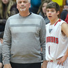 WARREN DILLAWAY / Star Beacon<br /> JOHN BOWLER, Edgewood boys basketball coach, and Mitchell Dragon watch a Campbell Memorial player shoot foul shots on Friday night at Edgewood.