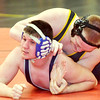 WARREN DILLAWAY / Star Beacon<br /> SETH STROCK of Grand Valley wrestles Kyle Compton of Avon Lake on Saturday during a 160 pound bout at the Perry Pin City Tournament.