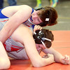 WARREN DILLAWAY / Star Beacon<br /> MITCH BOHNIC of Madison (top) wrestles Derrick Elrod of Edgewood on Saturday during aa 182 pound bout at the Perry Pin City Tournament.