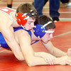 WARREN DILLAWAY / Star Beacon<br /> TANNER PERRY (left) of Edgewood wrestles Tyler McGroder of Madison during a 120 pound bout on Saturday at the Perry Pin City Tournament.