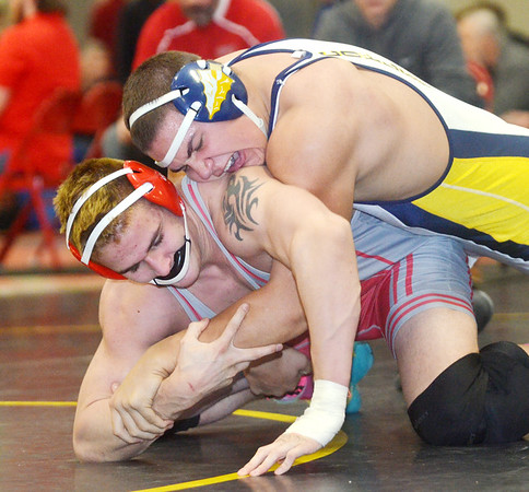 WARREN DILLAWAY / Star Beacon<br /> TYLER DUFOUR of Edgewood (left) wrestles Terrence Williams of Copley (top) on Saturday during a 220 pound bout at the Perry Pin City Tournament.