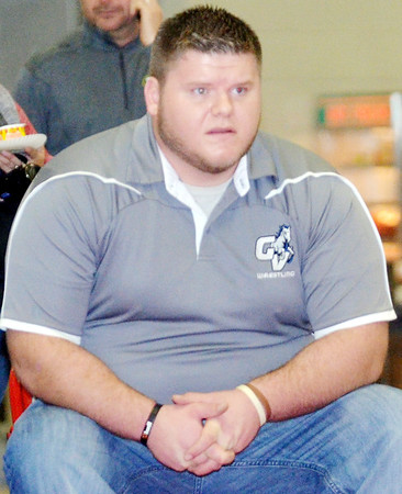 WARREN DILLAWAY / Star Beacon<br /> CHRIS DURIS, Grand Valley wrestling coach, watches thee action on Saturday during the Perry Pin City Tournament.