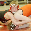 WARREN DILLAWAY / Star Beacon<br /> EVAN SCHENK of Perry wrestles Teagan O'Sullivan of Erie Cathedral Prep in a 160 pound bout on Saturday at the Perry Pin City Tournament.
