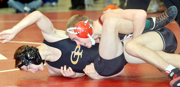 WARREN DILLAWAY / Star Beacon<br /> BRADY TOTH of Perry wrestles Tyler McKInney of Erie Cathedral Prep during a 113 pound bout on Saturday during the Perry Pin City Tournament.