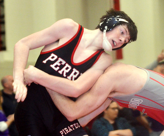WARREN DILLAWAY / Star Beacon<br /> FRANK DUNCAN (face hidden) of Edgewood wrestles Dylan Bentley of Perry on Saturday during a 152 pound bout at the Perry Pin City Tournament.