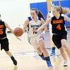 WARREN DILLAWAY / Star Beacon<br /> JESSICA VORMELKER (12) of Grand Valley squeezes by Nicole Iden (15) and Newbury teammate Cory Morin on Monday evening in Orwell.